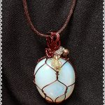 Opalite rounded set in copper hand made wire setting. cord included