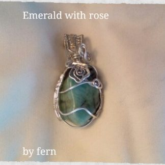 5.Emerald rough polished stone with rose crystal
